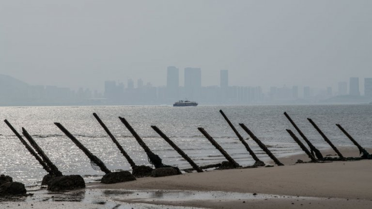 he Chinese city of Xamen is seen in the distance behind aged anti-landing barricades on a beach facing China on the Taiwanese island of Kinmen which, at points lies only a few miles from China, on April 19, 2018 in Kinmen, Taiwan.
