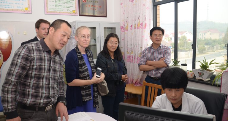 Karen Eggleston and peer researchers visiting with colleagues in China..